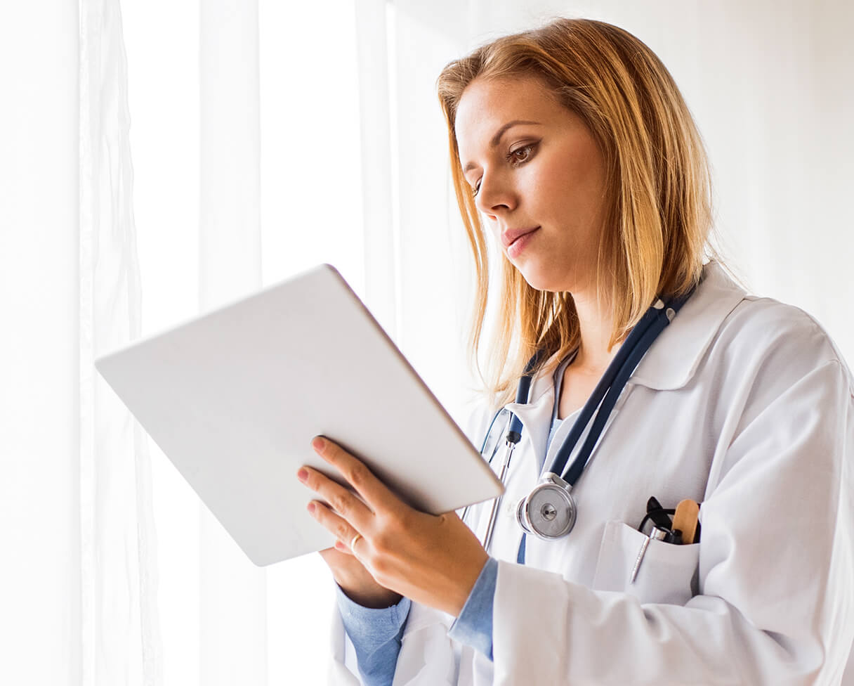 Woman reading medical report